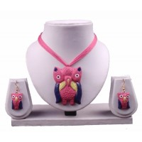 terracotta owl set in pink